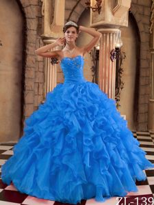 Beautiful Beaded and Ruched Quinceanera Dress with Ruffles in Blue Color