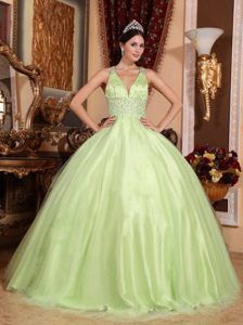 Latest V-neck Yellow Green Tulle Dress for Quinceaneras with Crisscross