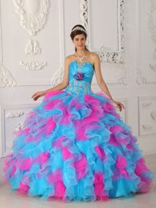 Strapless Blue and Fuchsia Appliqued Dress for Quince with Flowers and Ruffles