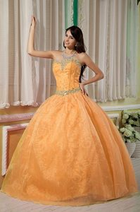 Exclusive Lace-up Organza Satin Orange Quinces Dresses with Beading