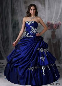 Ruched Appliqued Royal Blue Quinces Dresses Decorated with Handmade Flower